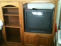 Beautiful wall unit with glass door and shelves. Holds