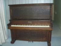 Old Oak Upright Piano - approx. 100 yrs. old - needs
