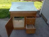 Used oak vanity with drawers Good shape  Sink included