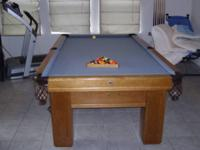 Beautiful Oak Pool Table with a blue felt top with