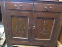 Nice oak buffet with 2 cabinets and two attractive
