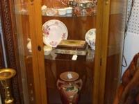 You are looking at a great vintage bow front oak curio
