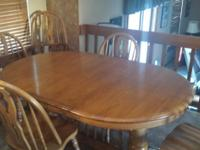 Type:Dining Room Solid oak dining table with 6 chairs.