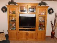 Solid Oak Entertainment. Center section will hold up to