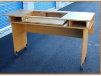This is an oak sewing and quilting table. The leaf on