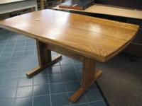 This is a very good condition, sturdy oak table. You