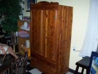 Nice CEDAR Wardrobe has bar for hanging clothes. Made