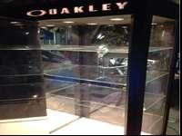 For sale lighted Oakley display case very nice five