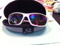 White Oakley sunglasses with Oakley case. They are a