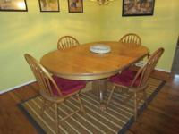 This is a beautiful dining table with 4 chairs