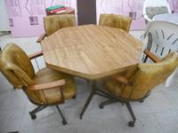 Octagon Shape Table w/ 4 Cushion Rolling Chairs in good