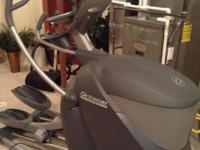 like new Octane Q47 elliptical with smart stride, arm