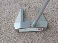 This is a Odyssey XG # 7 putter with a center shaft. 35
