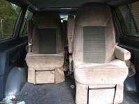 2 Captain's Seats beige velour from a 1999 Ford E-150.