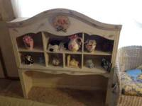 This beautiful piece is solid wood. Has many shelves to