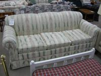 Off-white couch with mauve and green striped pattern.