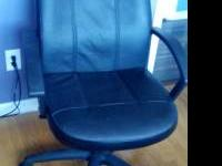 Standard rolling office chair. Shows signs of normal
