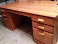 Beautiful executive desk.  Light Oak.  Drawers don't