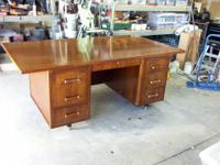 This desk is solid wood. It had been in he family about