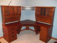 Seven piece office suite three piece desk, two hutches,