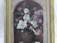This is a beautiful oil painting of flowers. The frame