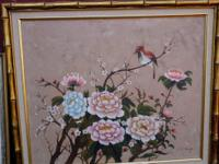 Flowers and bird, this framed art resembles Asian art.