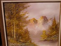 Mountain scene, water below, brilliant colors. Oil