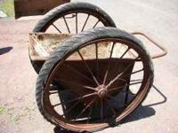 Old 2 wheel cart or wheelbarrow used for concrete. Has