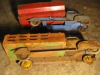 Old 40's Marx trucks - one stake and one grain. Wheels