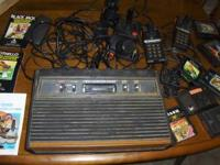 Old Atari 2600 Console, contollers & games. Also a