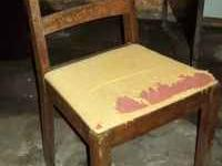 Old wooden chair. Shows use and wear. Located in