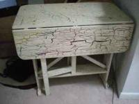 this is an old antique table that I painted multi