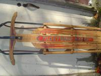 this is a antique fleetwing racer snow sled mfg. by