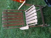 Groovy old rocking chair. Folds up! One side of the