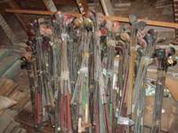 Old golf clubs - wood heads, steele shafts, bundles of