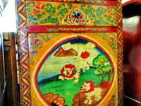This hand painted Tibetan Buddha cabinet came from the