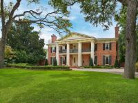 This Greek Revival masterpiece with Georgian Colonial