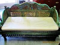 This beautiful hand carved teak wood bench came from