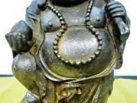 Budai is traditionally depicted as an obese, bald man