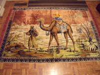 OLD LARGE FRINGED RUG WITH A MIDDLE EAST SCENE, VERY