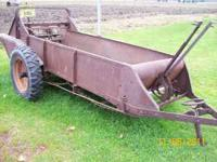 old manure spreader works good asking $650 phone calls