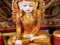 This old marble Mahamuni sitting Buddha statue came