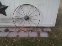 Metal Wagon Wheel for Sale. It has been