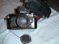 Older Nikon Camera with attachments. Has been kept for