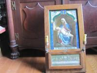 Old oak shadow box design hanging Catholic Communion