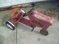 I have an old pedal tractor that needs some TLC. Asking
