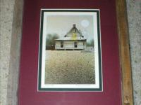 This vintage art print is an old prairie house. It is