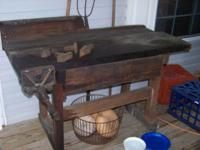 Old primitive work bench with vise. Very solid and