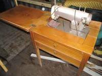 I have an old sewing Table with a Sears/Kenmore sewing