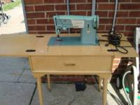 singer sewing machine for sale works asking $50.00